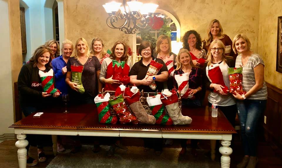 Cookie Bandits with their stockings for troops in 2019.