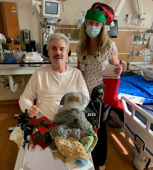 Distributing holiday stockings and care items to a veteran patient